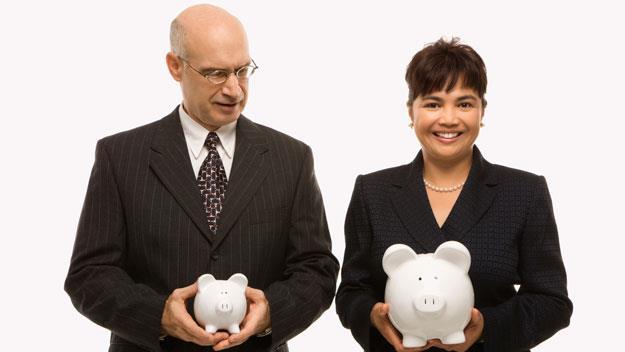 man and woman golding piggy banks, thinkstock