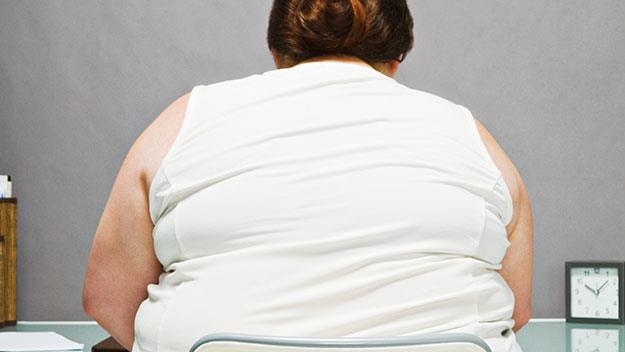 Overweight woman sitting backfaced in chair