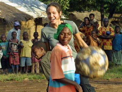 Angelina plays with the children she helped at Lugufu Camp, Tanzania.