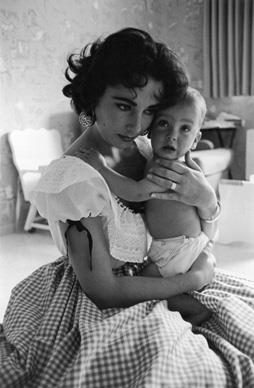 In 1956, Liz with Christopher, her second son, who was barely a year old and shared a birthday with his mother, February 27.  Photos from *Elizabeth Taylor A Life in Pictures* by Yann-Brice Dherbia, published by Pavilion books