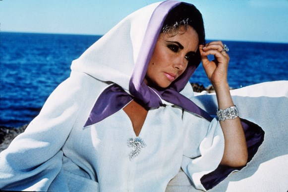 On the Mediterranean set of the 1968 movie *Boom!* With a script by Tennessee Williams and based on one of his plays, the film also starred Liz's fifth husband, Richard Burton, and Noel Coward.  Photos from *Elizabeth Taylor A Life in Pictures* by Yann-Brice Dherbia, published by Pavilion books