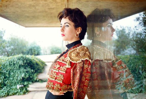 """In 1956 Liz poses in a bullfighter's """"suit of lights"""" that she bought in Spain.  Photos from *Elizabeth Taylor A Life in Pictures* by Yann-Brice Dherbia, published by Pavilion books"""