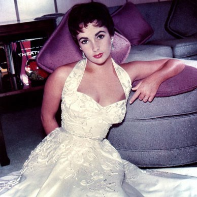 The classically elegant Elizabeth Taylor gives a sultry pose for the camera, circa 1970.  Photo by Michael Ochs Archives/Getty Images