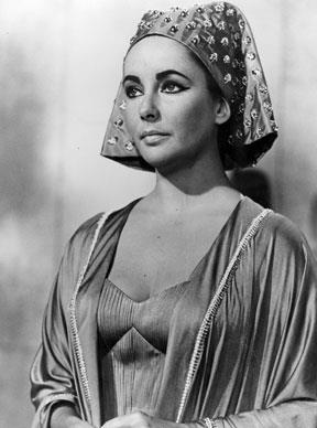 Taylor wearing one of the sixty costumes specially designed by Irene Sharaff for her role as the Egyptian queen in the 20th Century Fox epic *Cleopatra* in 1961.  Photo by Central Press/Getty Images