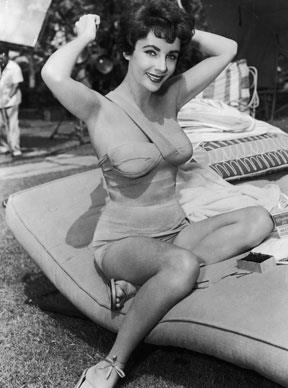 Combing her hair in a bathing suit on the set of director Richard Thorpe's film, *The Girl Who Had Everything* in 1953.  Photo by Hulton Archive/Getty Images