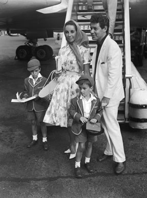 1959: Elizabeth Taylor arriving with husband Eddie Fisher and family at London Airport, having flown from Costa Brava where she has been filming *Suddenly, Last Summer*.  Photo by Keystone/Getty Images