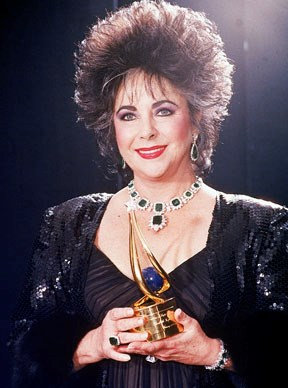 Actress Elizabeth Taylor holding her unident award.  Photo by David Mcgough/DMI/Time Life Pictures/Getty Images