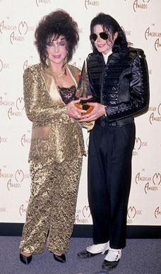 Elizabeth poses alongside singer Michael Jackson in a gold pants suit at the American Music Awards.  Photo by Life Pictures/DMI/Time Life Pictures/Getty Images