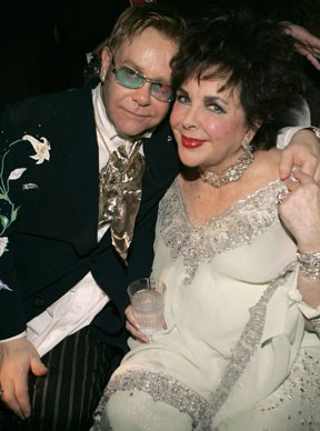 Sir Elton John poses with Elizabeth Taylor.  Photo by Kevin Mazur Archive 1/WireImage/Getty Images