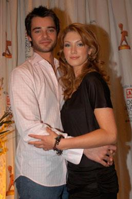 Delta kickstarted her career in the successful Australian drama serious *Neighbours*. Here she is with then co-star Daniel Collopy at the Logie Award Nominations in Melbourne 2003.