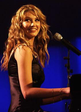 Delta Goodrem performs during the presentation of the Allan Border Medal at the Crown Palladium Ballroom in Melbourne in 2003. The Allan Border Medal is awarded to Australia's best cricketer over the last 12 months in Tests and One-Day Internationals.