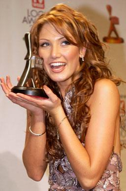 Delta scoops up the Silver Logie for 'Most Popular New Female Talent' on May 11th 2003 in Melbourne.