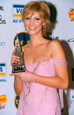 """Delta Goodrem dominated the 17th Annual ARIA Awards taking home seven of the prestigious awards including 'Best Female Artist' and 'Single of the Year' for """"Born To Try"""". Delta was diagnosed with Hodgkin's disease in the same year resulting in the need for strong treatment to ensure a successful recovery."""