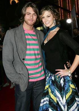 Delta's relationship with Ex-Westlife member Brian McFadden had controversial beginnings. McFadden's first wife Kerry Katona, who he married in 2002, is mum to his 2 daughters however they split in 2004. Negative press suggested Goodrem was part of the reason of the divorce. Nonetheless, Goodrem and McFadden remained together and are now engaged. Here, they attend the inaugural MTV Australia Video Music Awards in Sydney 2005.