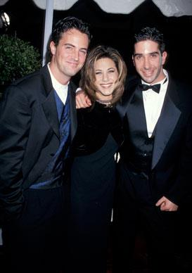 Jennifer is all smiles with Matthew Perryand David Schwimmer at the 21st Annual People's Choice Awards in 1995.