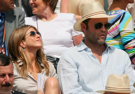 Jennifer soaks up the sun with now ex-boyfriend Vince Vaughn at the men's single final between Roger Federer and Rafael Nadal at the French Open in 2006.
