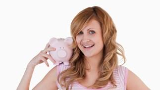 woman holding piggy bank
