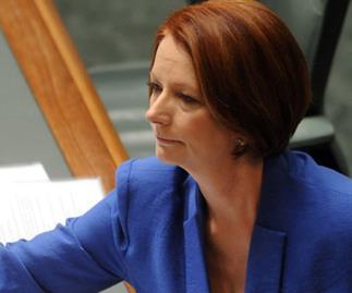 Tears in parliament as Gillard remembers dad