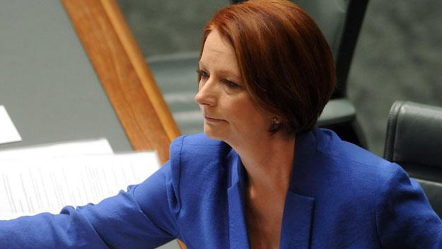 Tears in parliament as Gillard remembers dad