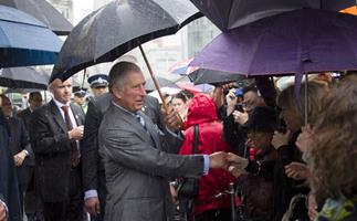 Charles and Camilla get rainy reception in Auckland