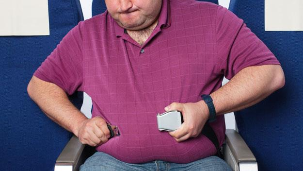 Fat man in airplane seat