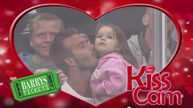 David Beckham and Harper Beckham kiss on camera.