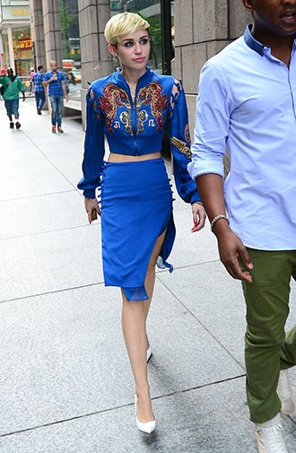 A blue cowboy shirt and tight skirt in June 2013.