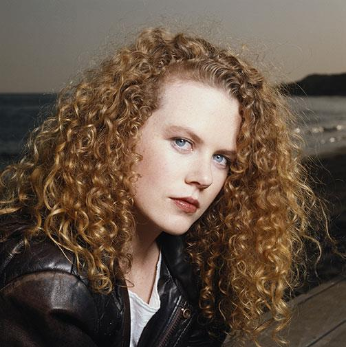 Nicole with some crazy curls in 1990.