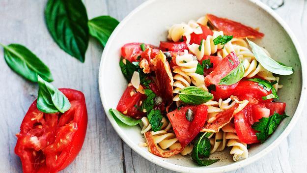 Pasta salad with tomato and crisp prosciutto