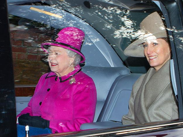 The Queen wearing her favourite pink outfit in December 2011.