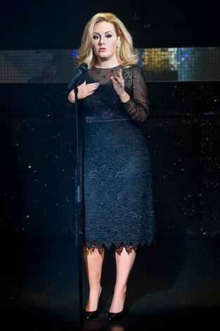 Curvy songstress Adele says she is happy with her weight and would only diet if it affected her health.