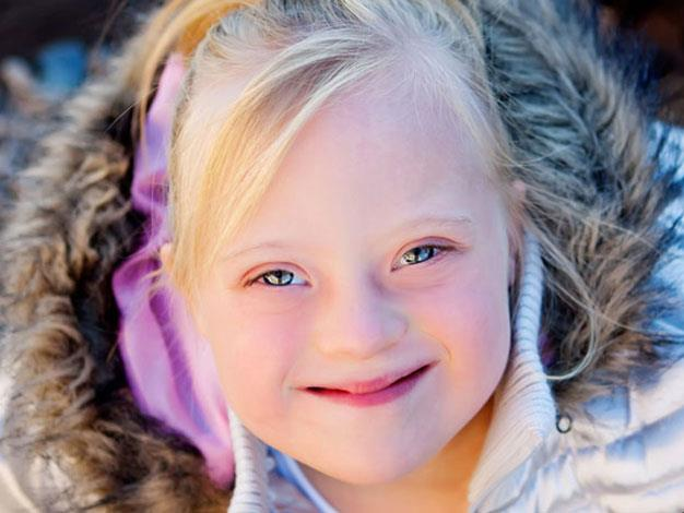 Ella Kinder, a child model with Down syndrome. Photo by Carrie at photographybycarrieperez.com.