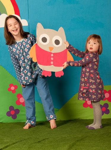 Five-year-old Natalia Goleniowski (right) also has Down syndrome but models for Frugi.