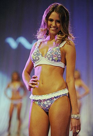 Modelling swimwear while competing to become Miss Universe Australia in June 2010.