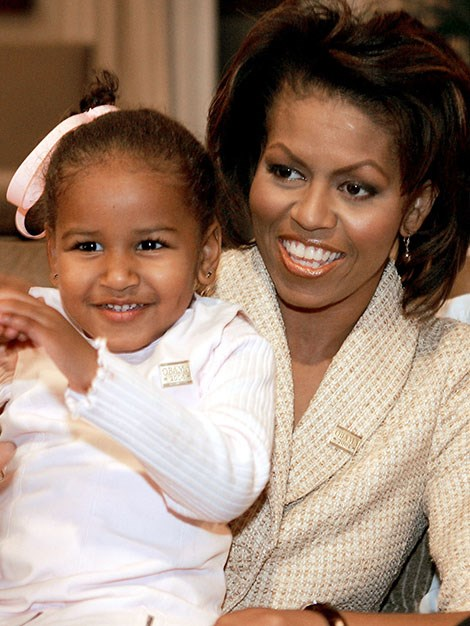 Michelle sits with her daughter, Sasha and waits for the 2004 senate election results to come in.
