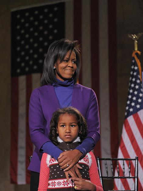 Michelle stands with daughter Sasha at a train station in Philadelphia. The first family made their way to the White House by train in January 2009.