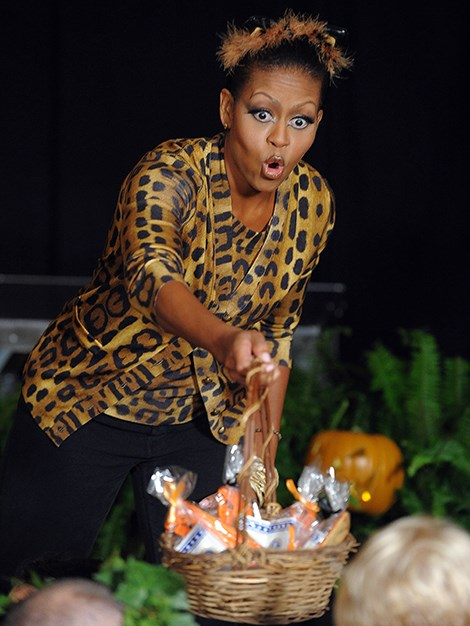 First Lady, Michelle Obama, hands out candy to the trick or treaters who visit the White House.