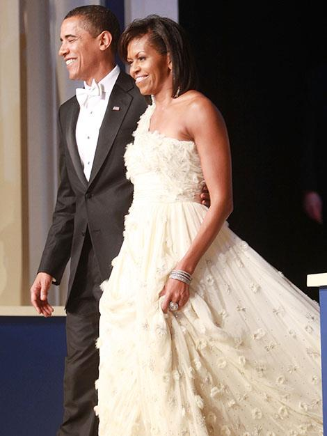 The first couple at the Mid-Atlantic Inaugural Ball in January, 2009 where Michelle wore an flowing cream grown.