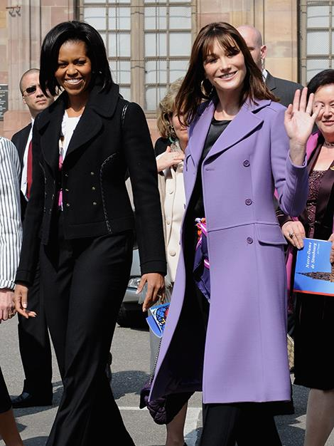 U.S First Lady Michelle Obama and French First Lady Carla Bruni-Sarkozy depart from the Cathedral of Starsbourg, France during the 2009 NATO summit.