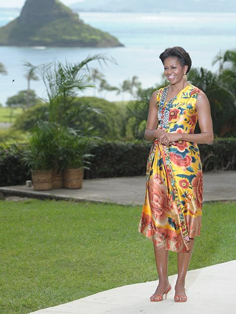 First Lady Michelle Obama waits to greet the wives of various leaders as she hosts the APEC summit in Hawaii.