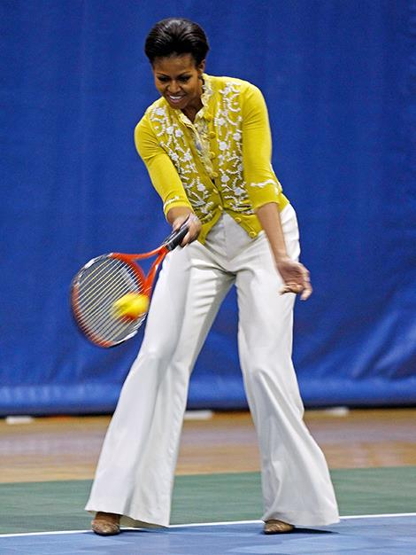 Michelle Obama showing off her racquet swinging skills at a children's event in 2012.