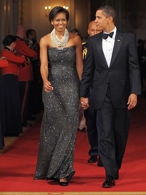 First Lady Michelle Obama shimmers her way to the Governors Ball in 2009 accompanied by President Barack Obama.