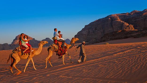 A family explores Wadi Rum.
