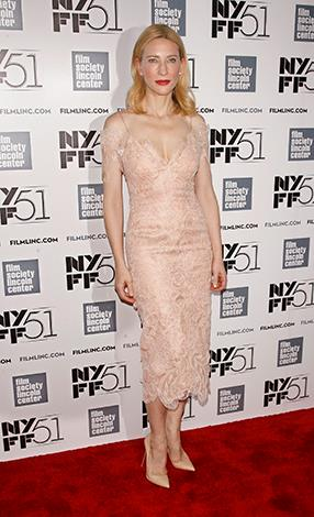 Lovely in lace: This pastel number teamed with nude pumps and a striking red lip is possibly the actress's best look ever!