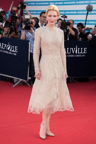 The Oscar winner looks otherworldly in this delicate high-neck lace dress.