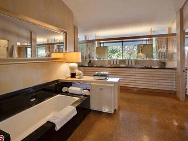 The master bathroom boasts a black marble bath.