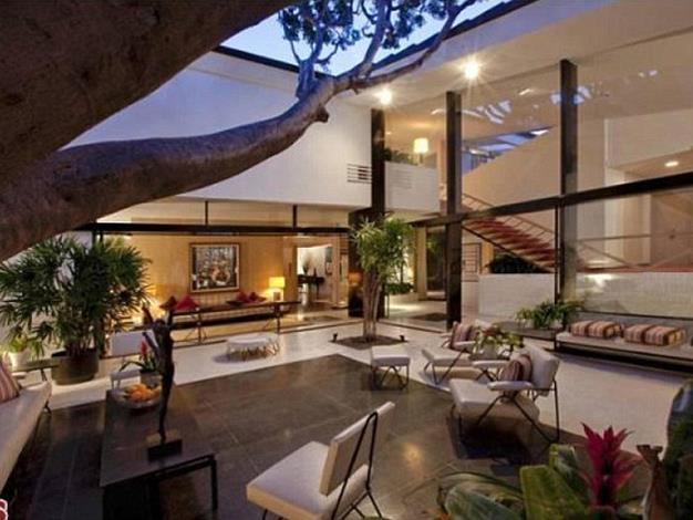 The home has several large glass walls.