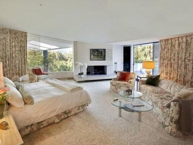 The master bedroom has its own fireplace.