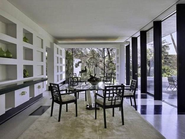 This stylish dining area has black and white marble floors.