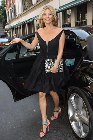 Kate arrive at London's Ivy in July looking every bit the chic supermodel in this LBD.